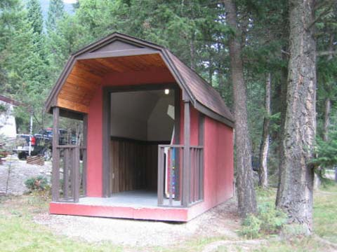 Red barn style shed that is used to house video games at an RV site near Radium Hotsprings