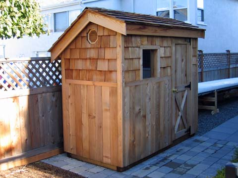a small garden shed can be very handy for storing garden tools and outdoor toys
