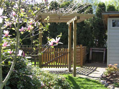 This Wood Garden Arbor Is Built With A Gate To Provide An Entryway Into Our  Friendu0027s